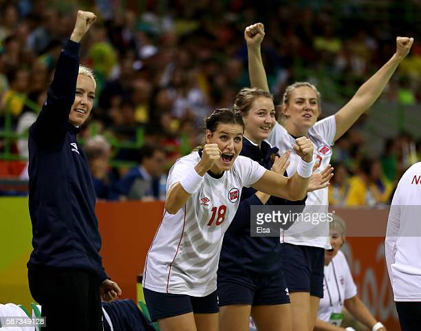 Linn-Kristin Riegelhuth Koren of Norway and the rest of the bench celebrate a save from Kari Aalvik Grimsbo in the second half against Spain on Day 3...