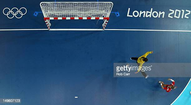 LinnKristin Riegelhuth Koren of Norway scores a goal in the Women's Preliminaries Group B handball match between Norway and Korea on Day 5 of the...