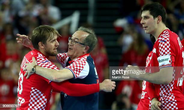 Lino Cervar head coach of Croatia celebrate with Luka Cindric after the Men's Handball European Championship main round match between Croatia and...