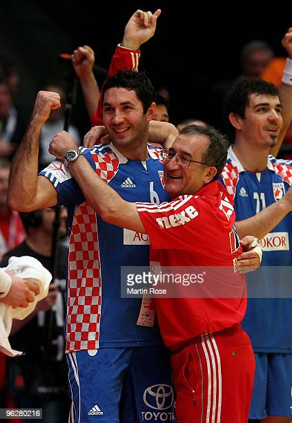 Lino Cervar head coach of Croatia celebrates during the Men's Handball European semi final match between Croatia and Poland at the Stadthalle on...