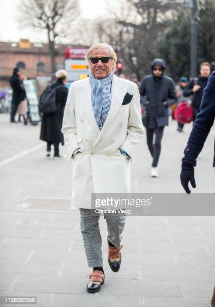 Lino Ieluzzi seen wearing creme white wool coat during Pitti Uomo 97 at Fortezza Da Basso on January 07 2020 in Florence Italy