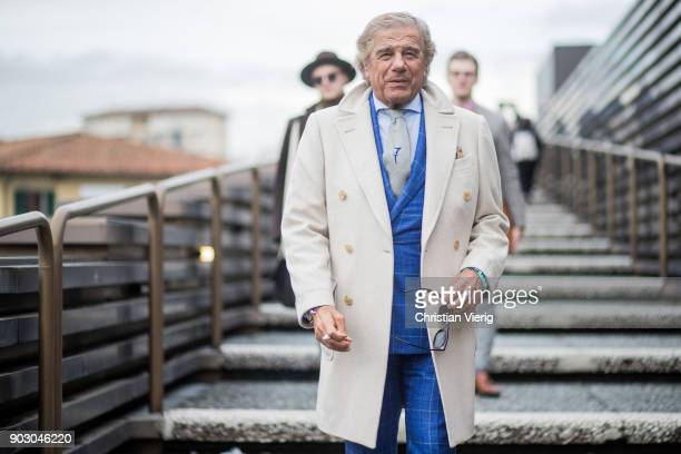 Lino Ieluzzi wearing checked blue suit creme coat is seen during the 93 Pitti Immagine Uomo at Fortezza Da Basso on January 9 2018 in Florence Italy