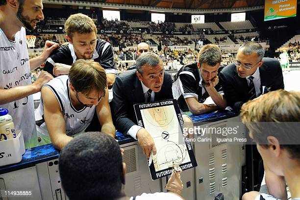 Lino Lardo head coach of Canadian Solar talks to his players during the Lega Basket Serie A playoff match between Canadian Solar Bologna v...