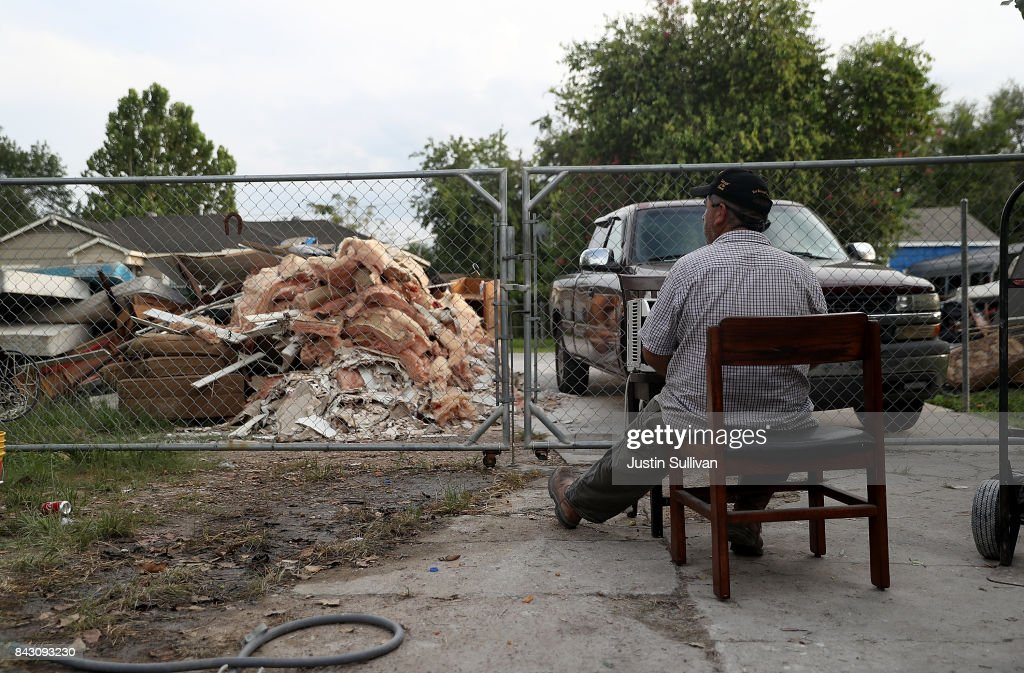 Lino Saldana looks at a pile of debris in front of his flood damaged home on September 5, 2017 in Houston, Texas. Over a week after Hurricane Harvey hit Southern Texas, residents are beginning the long process of recovering from the storm.