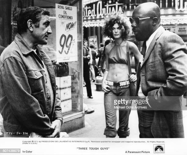 Lino Ventura and Isaac Hayes stake out a Chicago street corner in a scene from the Paramount Pictures movie Three Tough Guys circa 1974