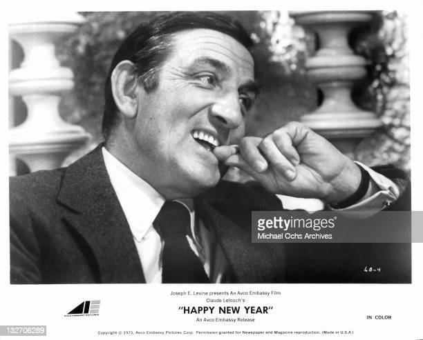 Lino Ventura biting on his finger in a scene from the film 'Happy New Year' 1973