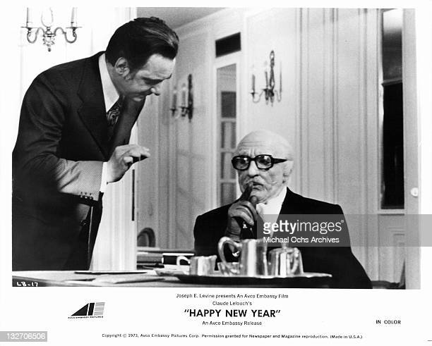 Lino Ventura checking with unidentified man who's asking him to be quiet in a scene from the film 'Happy New Year' 1973