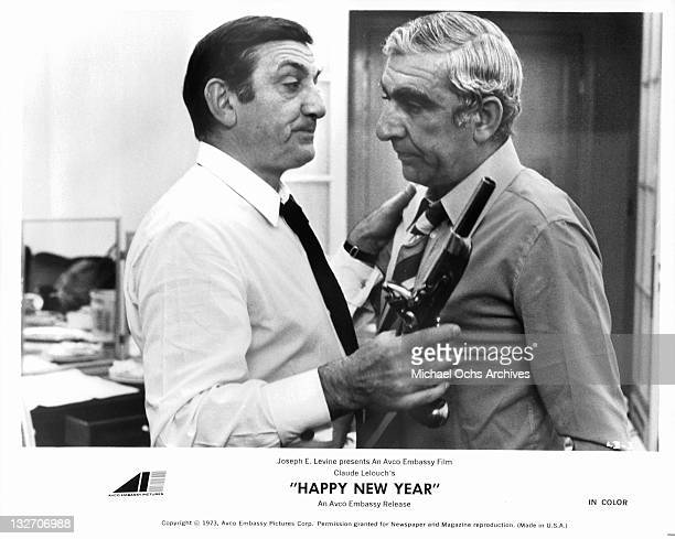 Lino Ventura getting up close with Charles Gerard in a scene from the film 'Happy New Year' 1973