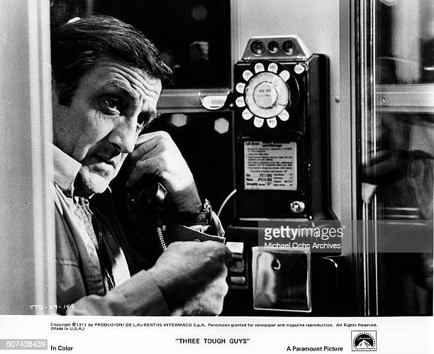 Lino Ventura makes a crucial phone call for outside help in a scene from the Paramount Pictures movie Three Tough Guys circa 1974