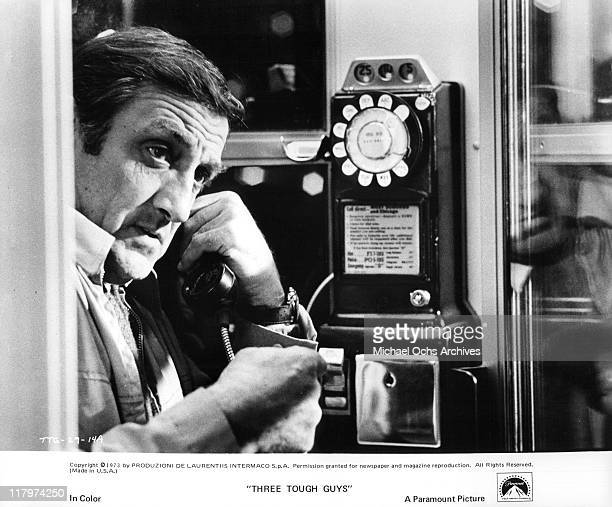 Lino Ventura on pay phone in a scene from the film 'Three Tough Guys' aka Tough Guys 1974