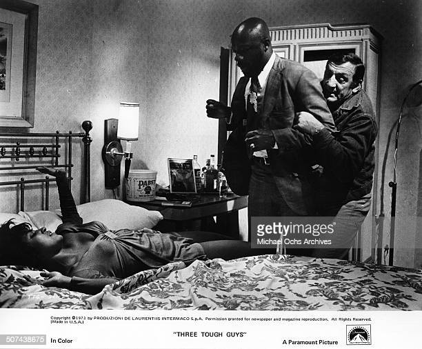 Lino Ventura restrains Isaac Hayes from harming Paula Kelly in a scene from the Paramount Pictures movie Three Tough Guys circa 1974