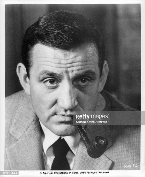 Lino Ventura smoking pipe in a scene from the film 'The Great Spy Chase' 1966