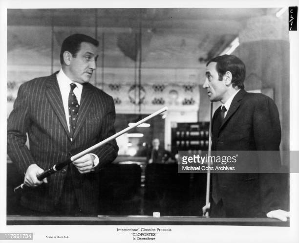 Lino Ventura talks with Charles Aznavour in a scene from the film 'Cloportes' 1965