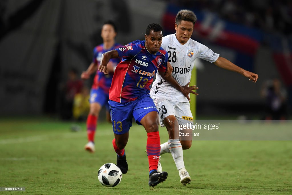 Lins of FC Tokyo and Hijiri Onaga of V-Varen Nagasaki compete for the ball during the J.League J1 match between FC Tokyo and V-Varen Nagasaki at Ajinomoto Stadium on July 27, 2018 in Chofu, Tokyo, Japan.