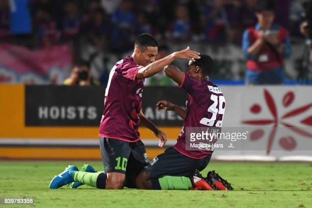 Lins of Ventforet Kofu celebrates scoring his side's first goal with his team mate Dudu during the JLeague J1 match between Ventforet Kofu and...