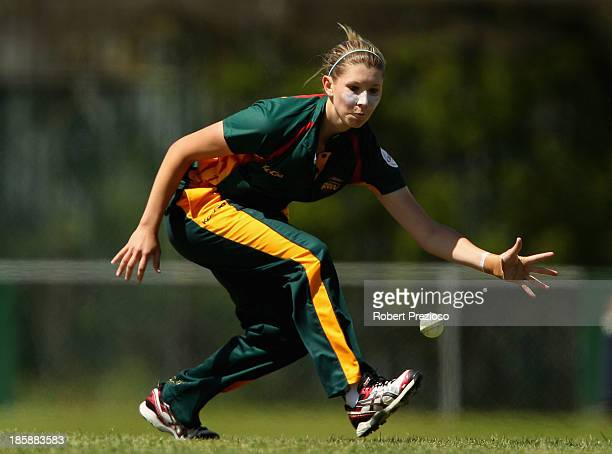 Linsey Da Costa of Tasmania fields the ball during the WNCL match between Tasmania and New South Wales at the NTCA Ground on October 26 2013 in...