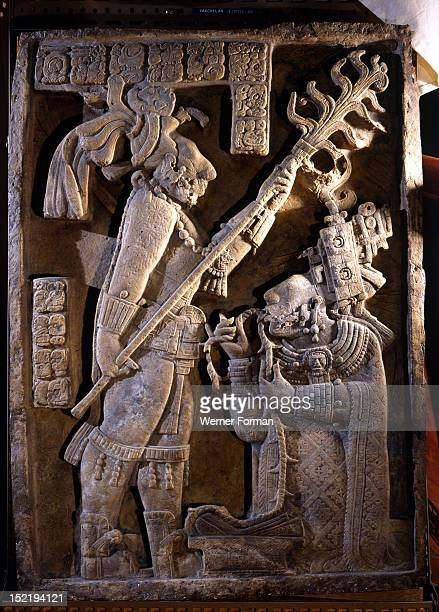 Lintel 24 of Yaxchilan Structure 23 from a series illustrating the accession rituals of the ruler Lord Shield Jaguar Here Shield Jaguar stands with a...
