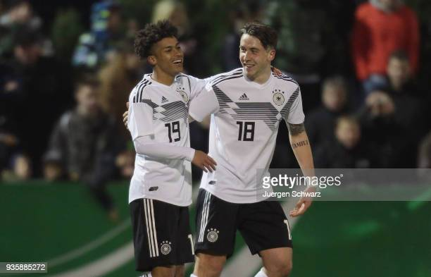 Linton Maina of Germany and Adrian Fein celebrate after the second goal during the Under 19 Euro Qualifier between Germany and Scotland on March 21...