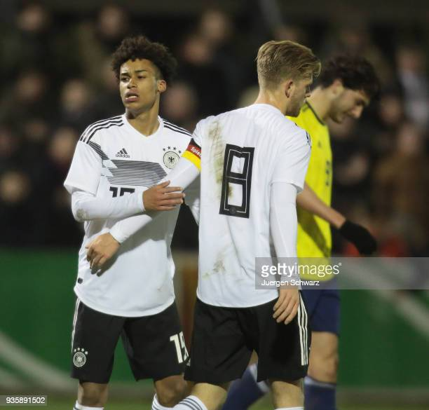 Linton Maina of Germany and Arne Maier celebrate the third goal during the Under 19 Euro Qualifier between Germany and Scotland on March 21 2018 in...