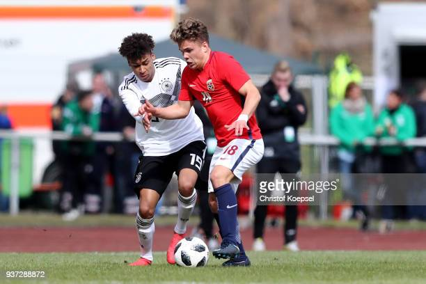 Linton Maina of Germany challenges Tobias Svendsen of Norway during the UEFA Under19 European Championship Qualifier match between Germany and Norway...