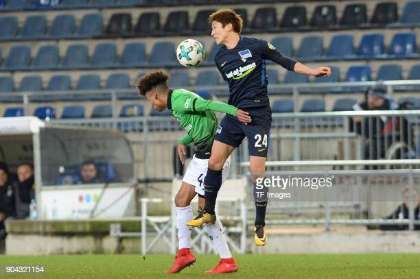 Linton Maina of Hannover and Genki Haraguchi of Hertha battle for the ball during the HHotelscom Wintercup match between Hertha BSC and Hannover 96...