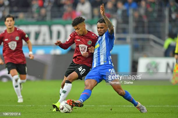 Linton Maina of Hannover and Valentino Lazaro of Berlin figt for the ball during the Bundesliga match between Hannover 96 and Hertha BSC at HDIArena...