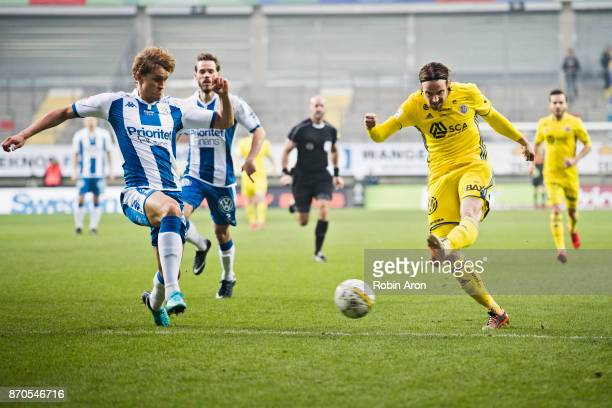 Linus Hallenius of GIF Sundsvall shoots and Mikkel Diskerud of IFK Goteborg tries to stop him during the Allsvenskan match between IFK Goteborg and...