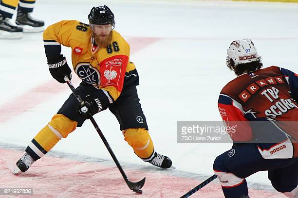 Linus Klasen of Lugano against Topscorer Roman Wick of Zurich in the second period during the Champions Hockey League Round of 16 match between ZSC...