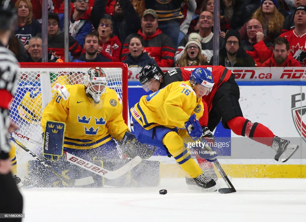 Linus Lindstrm #16 of Sweden goes after a rebound in front of Filip Gustavsson #30 in the second period against Canada during the Gold medal game of the IIHF World Junior Championship at KeyBank Center on January 5, 2018 in Buffalo, New York.