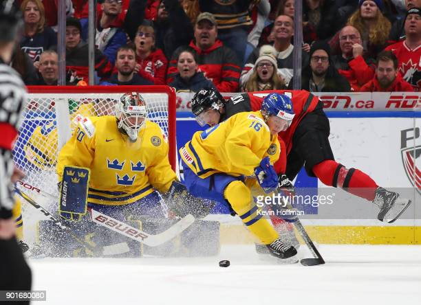 Linus Lindstrm of Sweden goes after a rebound in front of Filip Gustavsson in the second period against Canada during the Gold medal game of the IIHF...