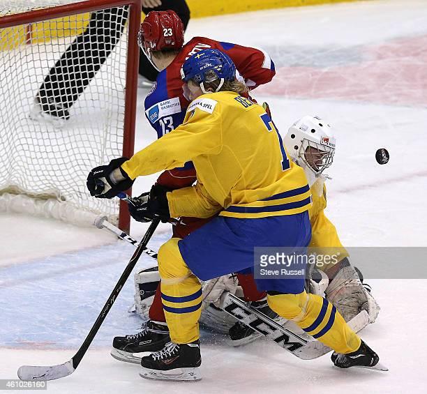 TORONTO ON JANUARY 4 Linus Soderstrom stops Ilya Korenev as Julius Bergman backchecks as Team Russia plays Team Sweden in the semi final round of the...