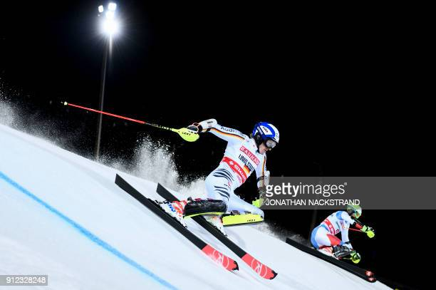 Linus Strasser of Germany and Ramon Zenhaeusern of Switzerland compete during the FIS Ski World Cup parallel slalom city event in Stockholm Sweden on...
