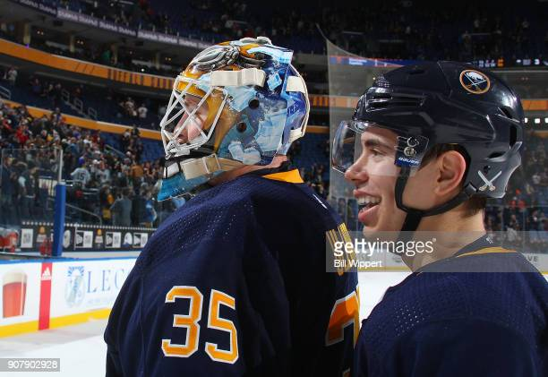 Linus Ullmark and Evan Rodrigues of the Buffalo Sabres celebrate a win against the Columbus Blue Jackets in an NHL game on January 11 2018 at KeyBank...