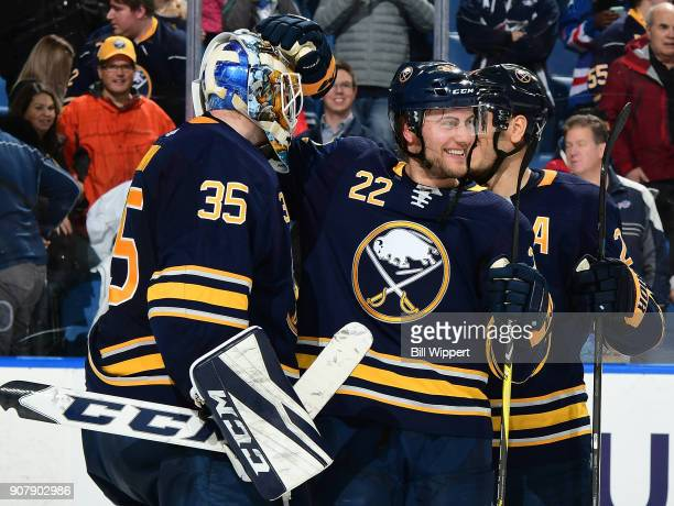 Linus Ullmark and Johan Larsson of the Buffalo Sabres celebrate a win against the Columbus Blue Jackets during an NHL game on January 11 2018 at...