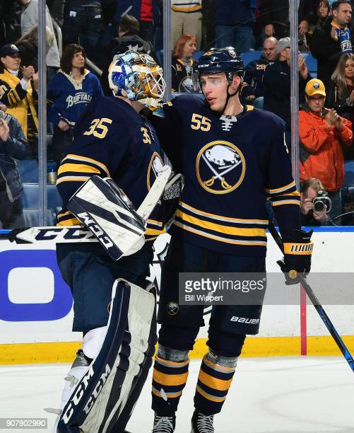 Linus Ullmark and Rasmus Ristolainen of the Buffalo Sabres celebrate a win against the Columbus Blue Jackets during an NHL game on January 11 2018 at...