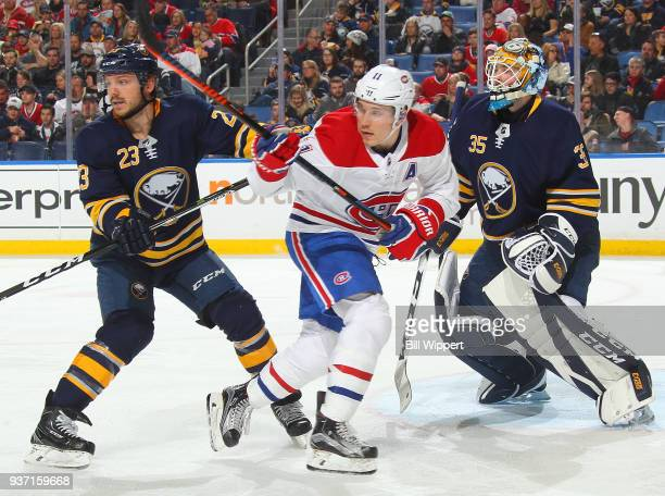 Linus Ullmark and Sam Reinhart of the Buffalo Sabres defend the net against Brendan Gallagher of the Montreal Canadiens during an NHL game on March...
