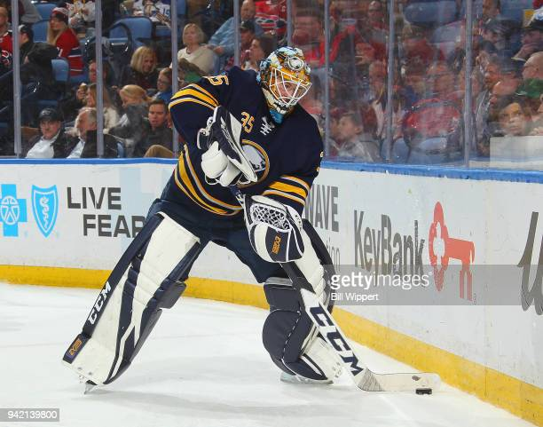 Linus Ullmark controls the puck during an NHL game against the Montreal Canadiens on March 23 2018 at KeyBank Center in Buffalo New York Linus Ullmark