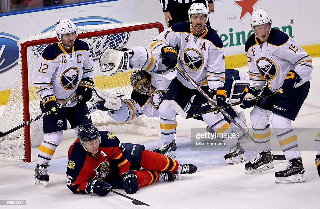Linus Ullmark #35 of the Buffalo Sabres dives in front of the net as Jussi Jokinen #36 of the Florida Panthers looks on during a game at BB&T Center on November 12, 2015 in Sunrise, Florida.