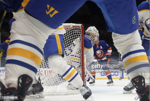 Linus Ullmark of the Buffalo Sabres keeps his eyes on the puck during the third period against the New York Islanders at the Nassau Coliseum on...