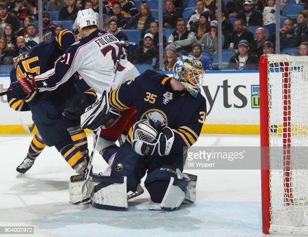 Linus Ullmark of the Buffalo Sabres looks back after making a save against the Columbus Blue Jackets during the second period of an NHL game on...