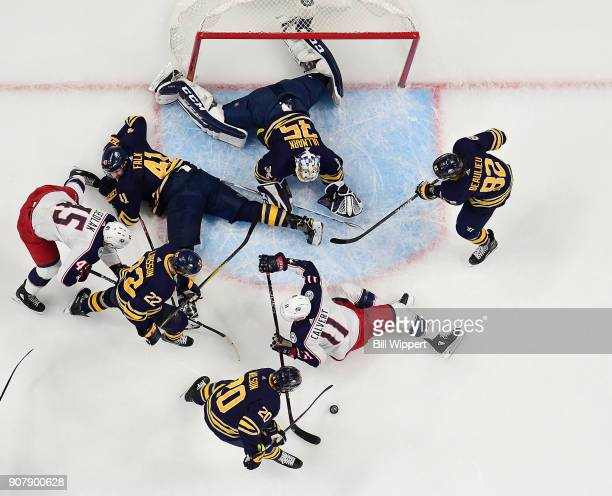 Linus Ullmark of the Buffalo Sabres makes a save against Matt Calvert of the Columbus Blue Jackets during an NHL game on January 11 2018 at KeyBank...