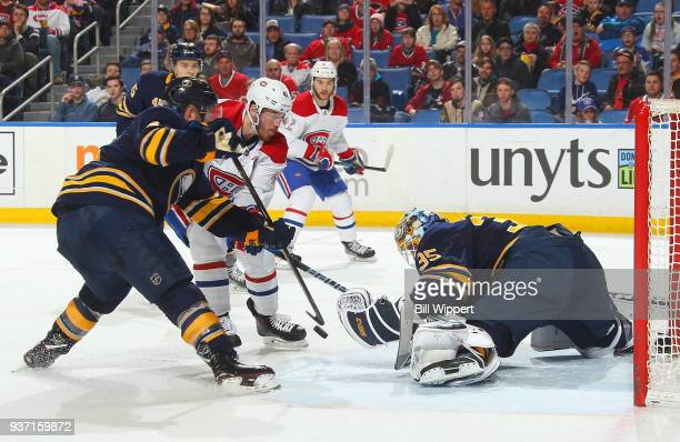 Linus Ullmark of the Buffalo Sabres makes a save against Paul Byron of the Montreal Canadiens during an NHL game on March 23 2018 at KeyBank Center...