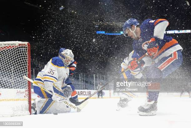 Linus Ullmark of the Buffalo Sabres makes the save on Oliver Wahlstrom of the New York Islanders at the Nassau Coliseum on February 22, 2021 in...