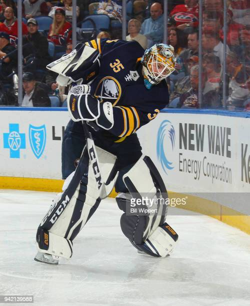 Linus Ullmark of the Buffalo Sabres passes the puck during an NHL game against the Montreal Canadiens on March 23 2018 at KeyBank Center in Buffalo...