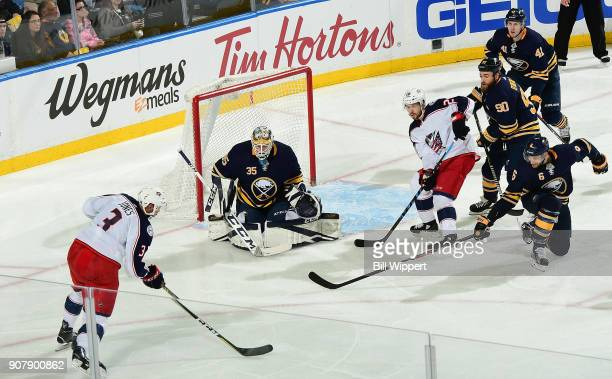 Linus Ullmark of the Buffalo Sabres tends goal against Seth Jones of the Columbus Blue Jackets during an NHL game on January 11 2018 at KeyBank...