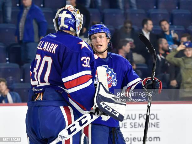Linus Ullmark of the Rochester Americans and teammate Conor Allen celebrate a victory against the Laval Rocket during the AHL game at Place Bell on...