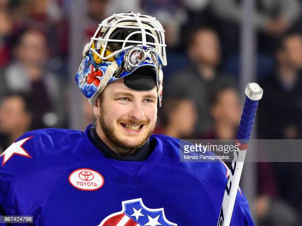 Linus Ullmark of the Rochester Americans smiles in the first period against the Laval Rocket during the AHL game at Place Bell on October 25 2017 in...