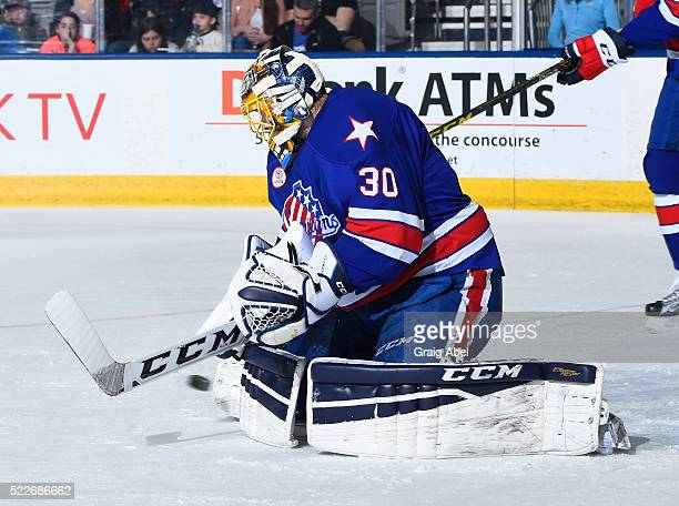 Linus Ullmark of the Rochester Americans stops a shot against the Toronto Marlies during AHL game action on April 17 at Ricoh Coliseum in Toronto...