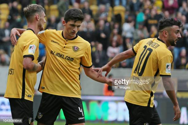 Linus Wahlqvist of Dynamo Dresden Jannis Nikoladou of Dynamo Dresden and Aias Aosman of Dynamo Dresden celebrate a goal during the Second Bundesliga...