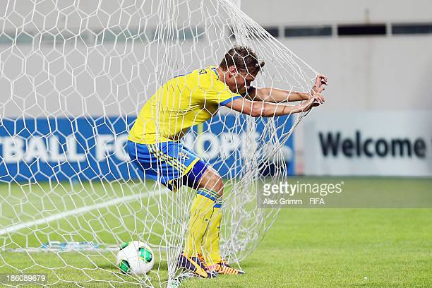 Linus Wahlqvist of Sweden reacts after scoring an own goal during the FIFA U17 World Cup UAE 2013 Round of 16 match between Japan and Sweden at...